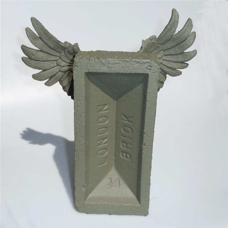 Front view of Winged Brick Sculpture (Olive on Olive)