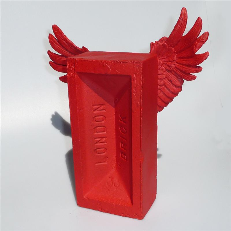 Front view of Winged Brick Sculpture (Red on Red)