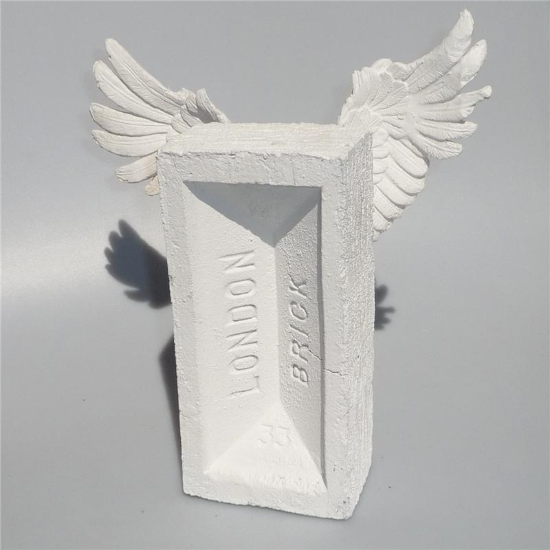 Front view of Winged Brick Sculpture (White on White)